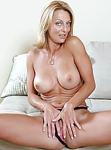 Milf Nippels, Bare skinned Brenda James spreads her pussy lips before drilling her juice box with a stiff dildo