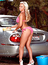 Suze Randall Nippels, Better than a Bond girl, bikini British beauty Robyn Truelove sets off car alarms with those curves of hers!
