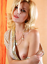 Naked True Beauty, Sexy blonde Yara is getting naked, while sitting on a chair in the hall