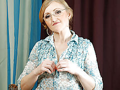 Breastfeeding Nipple, Sweet grandmother with glasses slowly unbuttons her blouse