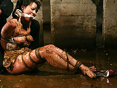 Fetish Vids: Petite brunette is bound and abused in an underground dungeon