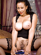 Naked Anilos, Busty Anilos Donna fucks her mature pussy with a huge dildo on the bed