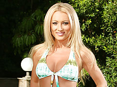 Mature milf Diana Doll hangs out poolside and gives an interview to Anilos.com