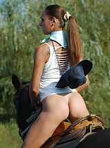 Naked stunning busty Alena riding horse