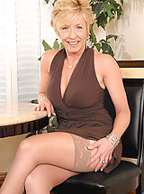Milf Pics: Hot tempting blonde Chanel torments her cougar snatch with a huge black vibrator