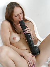 Brutal Dildos Nippels, Vanessa Licks And Inserts A Black Dildo In Her Pussy