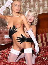 naked tits, Gorgeous girls Malgina and Kira strip each other down to their stockings on the bed.