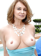 Anilos housewife moistens her glass toy and fucks her pink pussy outdoors