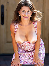 Naked Milf, Elegant mature woman flaunts her curvy bod outdoors in a sundress
