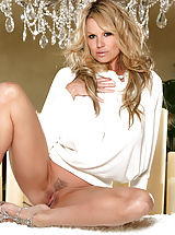 naked female, Kelly masturbates by candle light while using a crystal dildo.