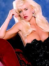 Naked Suze Randall, A sex goddess in her prurient prime disports herself on and off a chaise.
