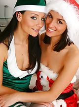 Puffy Nipples Pics, Sexy Santa Melanie and her little helper Carla unwrap themselves for you.