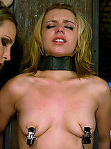 Fetish Pics: Hot young blonde in metal restraint and strapon fucked.