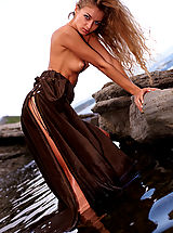 Girls Nipples, Gorgeous redhead shows her pussy posing on the rocks