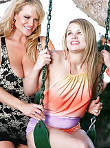 naked teens, Heather's teen pussy gets fucked while she's in a swing while she licks and sucks on Kelly's big ass titties.
