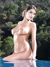 naked japanese, August Ames exposes her naked tits, pulls down her panties and opens her thighs and stimulates her tight pussy