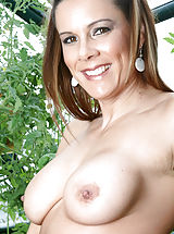 Erect Nipples, Brunette Anilos Victoria loves to expose her experienced shaved pussy while she hangs out in her garden