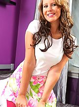 Courtney B looks stunning in her cute summer outfit with bright pink pantyhose and strappy sandals.