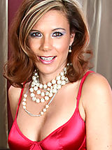 Milf Pics: Glamorous cougar Victoria shows off her satin dress