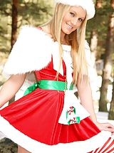 Naked Outdoors, Alexis wearing a santa's outfit with long stockings and boots.