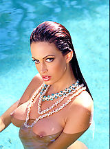 Erect Nipples, Ms. lovely legs Nikki Nova spreads them for you around a rock star's pool.
