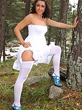 Bryoni-Kate in snow a strapless summer dress, white cotton panties and white hosiery.