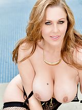 Julia Ann Slutty Woman shows her naked cans, draws down her panties and opens her legs and self pleasures her wet slit