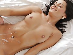 Brunette bombshell Mindy gets a sensual wakeup call that turns into raunchy sexcapades deep in her juicy creamy pussy