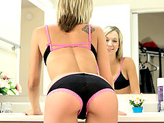 Nubile Amybrooke bends over in her booty shorts