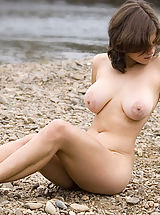 True Beauty Nippels, Brunette with big breasts posing naked on the beach