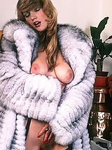 Classic hot lady in furry coat masturbates