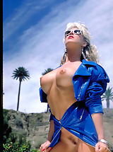 One of the sexiest pornstars from the '80's Angela Baron shows off her sizzling curves poolside!